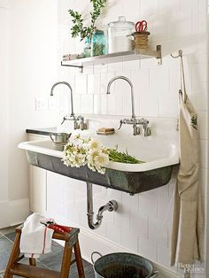 English cottages are often on working farms, where long days are spent outdoors. A mudroom is a smart way to confine grit and grime and provide a resting spot for boots, gloves, and hats before entering the house proper. Plus, durable, rugged slate and a long, trough-style sink look just as handsome indoors as they do outside. /