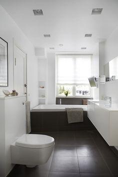 Floor tiles continue on the bath and wall.
