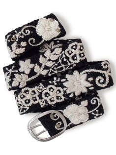 Thick and nubby embroidered belt with a solid base under a floral design. It's a little stretchy like a pair of jeans, and will conform to your body after a few days of wear. - 100% wool - Each belt h