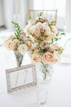 Bouquets that are used as centerpieces for the wedding reception | Melissa Robotti Photography | Theknot.com