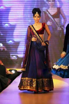 "Manish Malhotra, ""royal"" color combo and gold work.  A favorite for traditional look.  Would be interested if on sale."