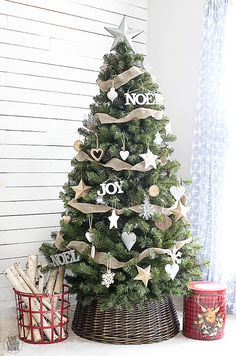 Rustic farmhouse christmas decor ideas ll help you decorate for chrismtas from bright and cheery to cute and chic. This list of rustic farmhouse christmas decor ideas also includes gorgeous christmas tree decorating schemes. For just a small touch of . Christmas Tree Inspiration, Woodland Christmas, Beautiful Christmas Trees, Christmas Tree Themes, Noel Christmas, Holiday Ornaments, Burlap Christmas Tree, Christmas Tree Base Cover, Christmas Christmas