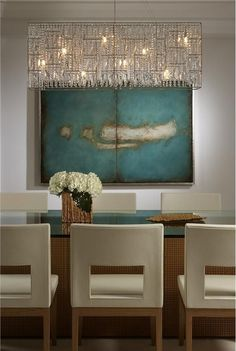 Dining Room - Contemporary art work & furnishings with an timeless colour palette set aglow with a dazzling modern chandelier.  Lovely  (re-pinned photo only Joseph Pubillones)