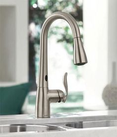 Kitchen Sink Remodel Moen Arbor MotionSense kitchen faucet - gun metal if possible - It doesn't take a lot of money or time to make a big difference. Consider these simple home improvements, which you won't believe you ever lived without. Best Kitchen Faucets, Bathroom Faucets, Kitchen And Bath, New Kitchen, Kitchen Ideas, Kitchen Faucets Pull Down, Bathroom Hardware, Kitchen Reno, Kitchen Inspiration