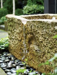 Another rough-hewn trough from Original Stone Troughs was adapted as a fountain, which now gurgles within earshot of Moore's home office.