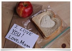 """Say """"I love you"""" this Valentine's Day with this lunchbox surprise <3 Make two-tone sandwiches with a cookie cutter and two different types of bread!"""