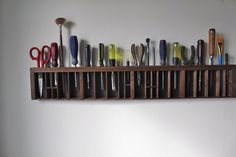Love this idea for organizing common household tools that generally are buried in my kitchen junk drawer. (Looks like I found Erik's summer project)