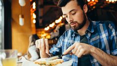 Handsome young man having lunch in elegant restaurant alone. Attractive guy is cutting his tasty sandwich with fork and knife. He is delighted because soon he will try this delicious dish , Control, Nutrition, Couple Photos, Food, Anxiety, Dietitian, Get Lean, Couple Shots, Eten