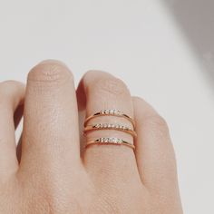 gold stacking rings with qtys of 9, 4, 11 diamonds on each different ring... my wedding date.
