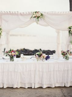 beach wedding reception - photo by Kylie Martin Photography http://ruffledblog.com/lavender-big-island-wedding