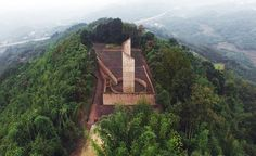 the monument sits at the top of a mountain, accessible only via a rough path that winds through the surrounding bamboo forest.