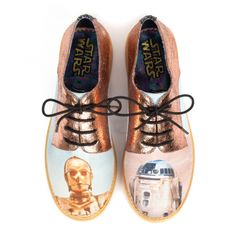 Star Wars | Irregular Choice Droids No Jedi should ever be without a trusty droid by their side and with our stunning lace up flats you never have to be! Featuring metallic rose gold cracked PU and faded vintage style C-3PO and R2-D2 graphic prints, this classic pair will be your saviours in times of wardrobe malfunction. Size 36-43.