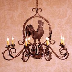 Had this rooster chandelier custom made in a black iron. Kitchen cabinet knobs and pulls will also be dark iron of not black.