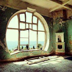Art Nouveau moon window on the Russian riviera in  abandoned Seagull Hotel