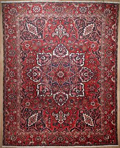 This beautiful Handmade Knotted Rectangular rug is approximately 10 x 13 Semi-antique area rug from our large collection of handmade area rugs with Persian Bakhtiari style from Iran/Persia with Wool