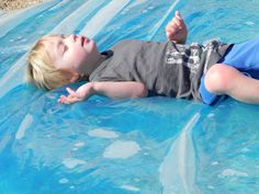 """""""redneck waterbed"""" duct tape the sides of a tarp then fill with blue food coloring and water-- it's like a giant sensory bag. I think it would be fun to put squishy plastic fish in too so that you can watch them """"swim"""" inside. Sensory Activities, Summer Activities, Toddler Activities, Sensory Play, Sensory Therapy, Family Activities, Projects For Kids, Diy For Kids, Cool Kids"""