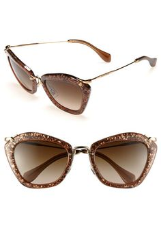 Delicate metal hardware composes the arched bridge and barely there temples of glitter-infused cat's-eye sunglasses with a decidedly vintage aesthetic.