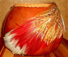 http://www.featherinthespiritwind.com/pages/decorateddrygourds.aspx