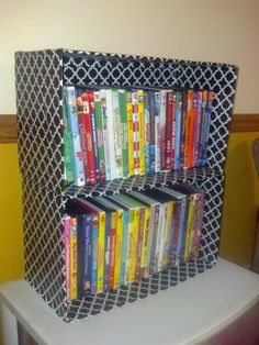 Up cycled diaper boxes - just cover them with contact paper! Perfect for dvd's.