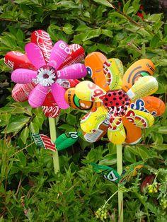 Super cool soda pop bottle pinwheels. The center is the bottlecap. :)