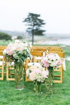 Stunning blooms line this outdoor ceremony: http://www.stylemepretty.com/california-weddings/2014/11/05/outdoor-summer-wedding-on-the-18th-lawn-at-pebble-beach/ | Photography: Troy Grover - http://www.troygrover.com/