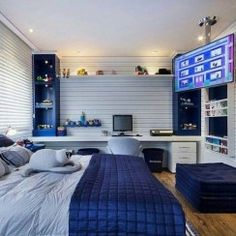 Affordable Bedroom Decor Ideas For Your Little Boys Excellent Teenage Boy Room Décor Ideas For You<br> Understanding the psyche of a teenage kid is the biggest challenge all parents face when it comes to decorating a … Gamer Bedroom, Bedroom Setup, Boys Bedroom Decor, Room Ideas Bedroom, Boy Decor, Boy Bedroom Designs, Teenage Room Designs, Bedroom Furniture, Guy Bedroom