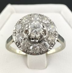 Art Deco Cluster Ring in 18 kt Grey Gold and Platinum decorated with Brilliant-Cut Diamonds for 1.35 ct.