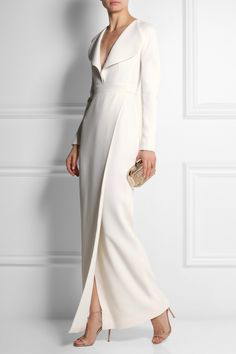 EMILIA WICKSTEAD Wrap-effect wool-crepe gown $5,615 Emilia Wickstead's elegant gown has been crafted in Italy from white wool-crepe and lined in silk. It has an exaggerated, rounded collar that flatters your décolletage and creates the illusion of a narrower waist. Channel the runway look and wear it beneath the label's bouclé coat.