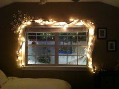 White twinkle lights and scarf wrapped around a grapevine (Soak in bathtub to loosen/stretch grapevine)