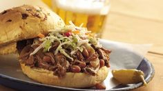 Loaded with beef and baked beans, saucy sandwiches satisfy hunger in a hurry. Coleslaw adds a cool crunch.