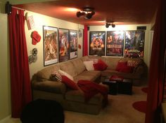 Our media room in the basement.  Ordered movie posters and red drape panels online, recovered pillows in funky red zebra print, and painted the ceiling red!
