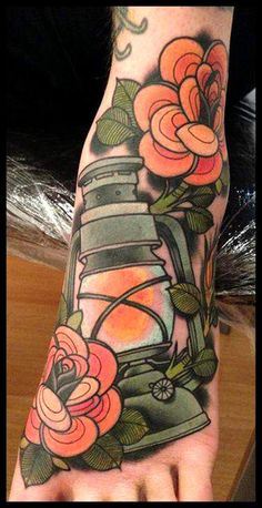 Classic lantern and flowers. I particularly love the way these flowers were stylized!  Tattoo done by Annie Frenzel.
