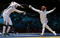 France's Laura Flessel-Colovic faces Romania's Simona Gherman in a women's individual epee fencing round of 16 match at the 2012 Summer Olympics, Monday, July 30, 2012, in London. (AP Photo/Andrew Medichini)