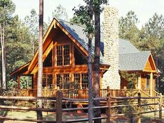 The 1,722 square foot log home blends seamlessly with the woods.