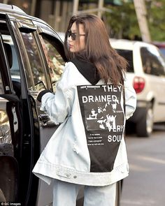 Grungy: The outfit was then given more of an edge with its distressed rips at the front an...