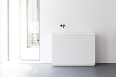Scape monolith has been expanded into these white Scape wall-placed elements produced in white Hi-Macs. Design Joost van der Vecht