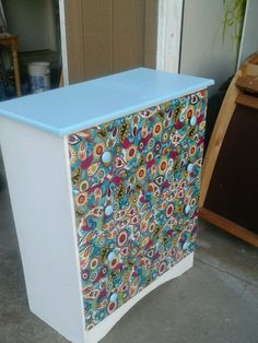 Old dresser in great shape just bad style.  Painted the top and nobs with left over paint from the walls.  Applied left over fabric that matched to the drawers with Mod Podge and added a Matte finish clear sealer.  Time: 1 day