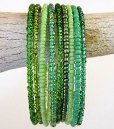 One color & size, various seed bed finishes - Green Memory Wire Bracelet Wide Cuff Stacked Wrap by JulepTulip. How pretty! Love the hues, so gentle on the eye Memory Wire Jewelry, Memory Wire Bracelets, Jewelry Bracelets, Bangles, Beaded Jewelry, Handmade Jewelry, Jewellery, Bracelet Fil, Diy Schmuck
