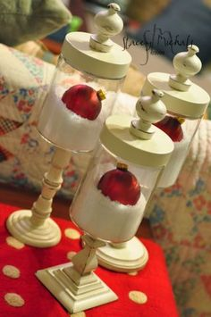 Apothecary jars - Dollar store canlde sticks, use a clear jar, add finials or small ornaments or any decorations on top of painted lid....