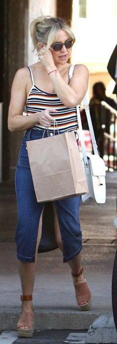 Who made Kate Hudson's white handbag and brown suede platform sandals?