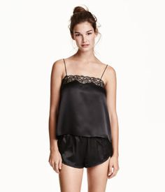 PREMIUM QUALITY. Pajamas with camisole top and shorts in silk satin. Wide-cut, short camisole with narrow shoulder straps and wide lace trim at top. Short shorts with narrow elastication at waist, wrapover sides, and lace trim at front.