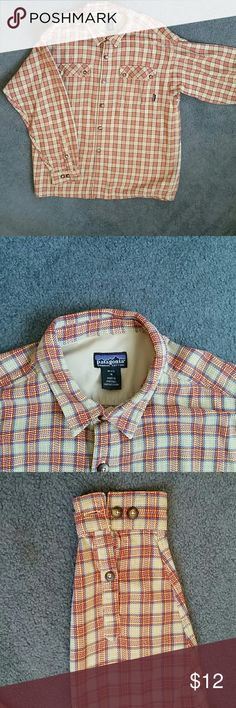 Vintage Patagonia Fjord Flannel shirt Men's size medium, medium weight, organic cotton Flannel shirt. Long sleeve. Great condition. Fits like a large, or baggy medium. Made before Patagonia started slimming down all clothes to super model athletic cuts. Patagonia Shirts Casual Button Down Shirts
