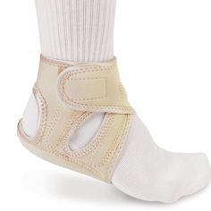 The Plantar Fasciitis Pain Relieving Heel Wrap - Hammacher Schlemmer - This is the heel pad that uses acupressure to relieve pain from plantar fasciitis.
