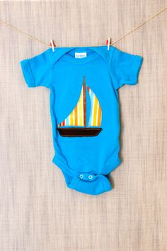 Onesie with striped sailboat for baby boy