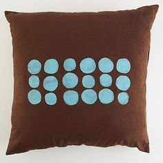 Designer-look pillows minus the price tag? We're in! Basic pillowcases cost only a few dollars at crafts stores. Buy several at a time, and screen-print them in the same afternoon to keep the look cohesive and the colors consistent. Your sofa will thank you.