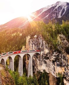 by Bernina Express winds its way through some of the most beautiful scenery in Switzerland at the Landwasser Viaduct situated near the town of Filisur. Places To Travel, Places To Visit, Bernina Express, Europe Bucket List, Visit Switzerland, Destinations, Paradis, Nature Photos, Sunrise