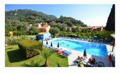 Irene Apartments Agios Gordios Surrounded by lush hills, just 300 metres from a mile-long beach, Irene Apartments is a family-run hotel with peaceful atmosphere, 15 kilometres from Corfu Town. The Irene apartments and studios range between 32 and 55 m². Fine Hotels, Best Hotels, Luxury Hotels, Irene, Agios Gordios, Corfu Hotels, Corfu Town, Cheap Hotels, Rocky Mountains