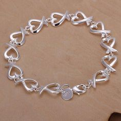 Price - $8.69 Silver Plated All Kelp Bracelet  Item Specifics: Material: Copper Plating: 925 Silver Plated Color: Silver Gender: Women Style: Europe and America Size: About 20.5 x 1.1cm Weight: About 12g Dress collocation: All-match