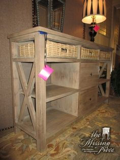 """Coastal style sideboard in a weathered finish with three woven baskets. There is a shelf on either side and two drawers in the center for storage. Could be used in a dining room or a living room. 57""""L x 15""""D x 34""""H."""