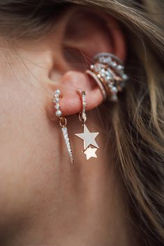Create your own ear stack with our hoops and ear ring pendants like this pearl and stars ear candy.